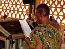 Traditional leader reading Gospel of Mark in Kaakye