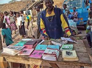 Man selling literacy books in the market
