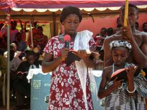 Woman and child reading the Bible in their language