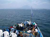 Mount Nyiragongo of the bow of the Safina on Lake Kivu