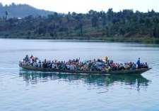 Overloaded canoe on Lake Kivu