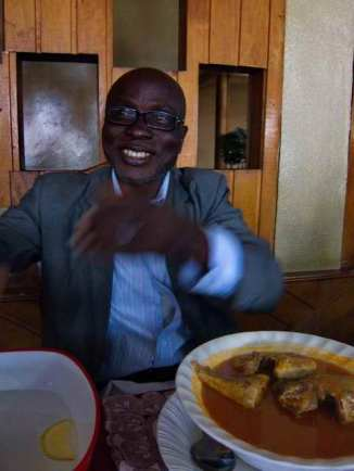 Alex Dotse, a colleague, with Ghanaian food