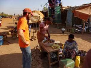 "Matthew buying ""gallettes"" by the road in Ougadougou"
