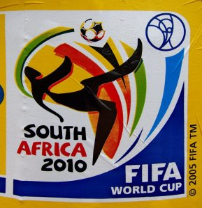 2010 official World Cup poster by FIFA. Found on a kiosk selling prepaid cell phone airtime in Kintembu, Ghana