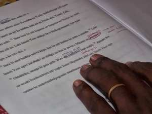 An Africa translator revises a draft translation
