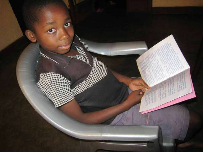 Congolese boy reading the Gospel of Luke in his language - Tembo