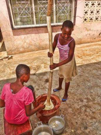 Ghanaian girls pounding fufu