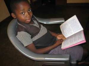 This Tembo boy, reading Luke in his language, will avoid wrong metamessages