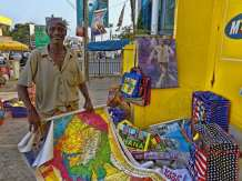 Man selling maps and bags