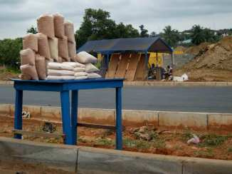Rice for sale beside road