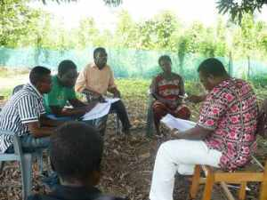 Composing Nkonya praise music under a mango tree