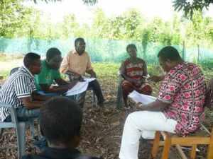 Composing Nkonya praise music under a mango tree
