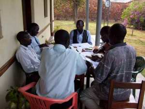 Congolese translators working with a consultant