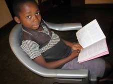 Tembo boy reading Luke in his language