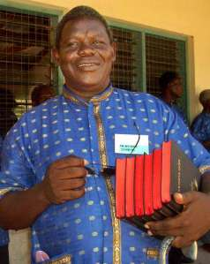 Pokomo man (Kenya) with 5 New Testaments