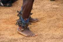 Traditional dancer with iron noise makers on his ankles