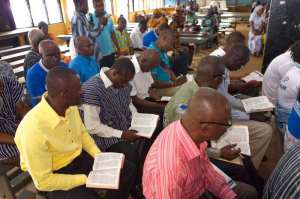 Ghanaian men consult their Bibles