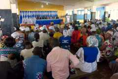 Christians brought to faith through the Northern Outreach Program listen to the Word together in a city in southern Ghana